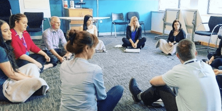An image of teachers taking part in twilight sessions, we provide mindfulness to support well-being or strategies to use in the classroom.